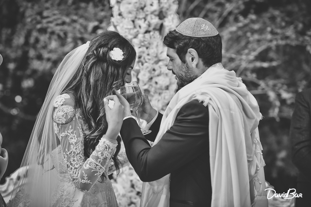 Blessing for the wine. Jewish wedding traditions