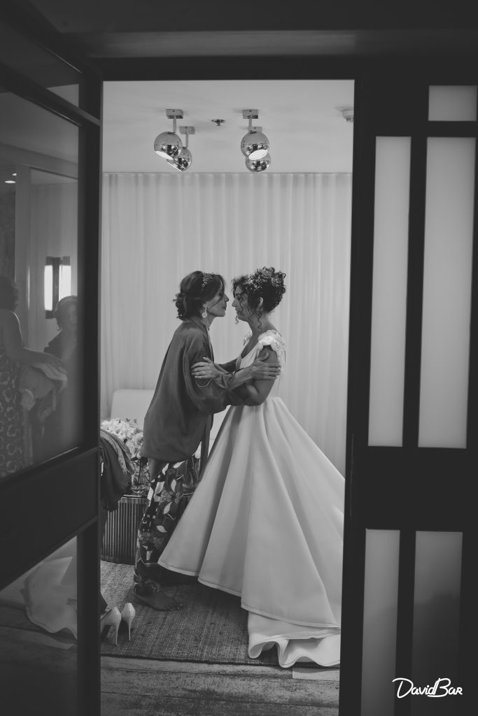 Mother preparing bride for wedding